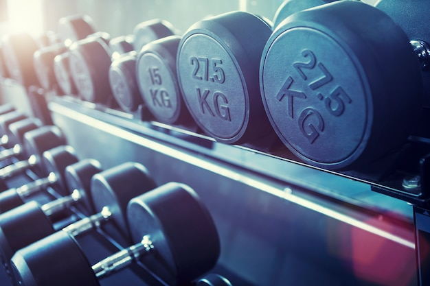 Row of dumbbells in gym. fitness background.