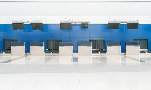 Row empty check-in desks in international airport
