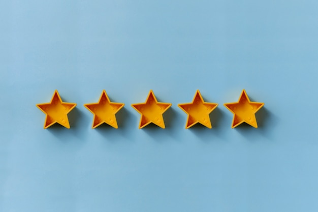 Row of five gold stars for excellence