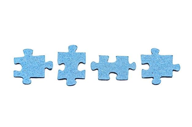 Row of four disconnected blue jigsaw puzzle pieces isolated on white