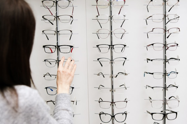 Row of glasses at an opticians. eyeglasses shop. stand with glasses in the store of optics.