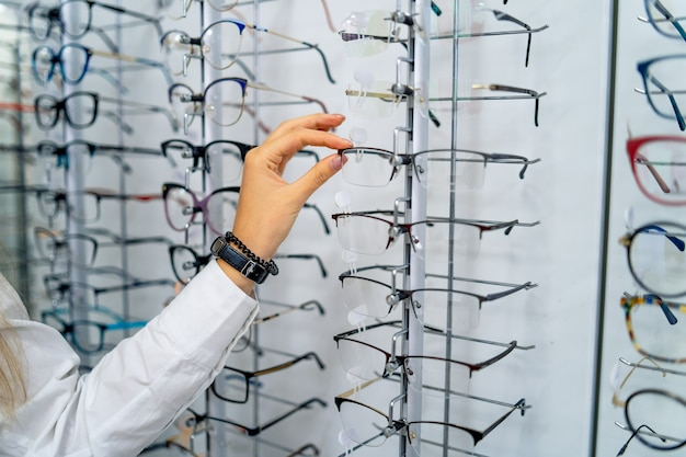 Row of glasses at an opticians. eyeglasses shop. stand with glasses in the store of optics