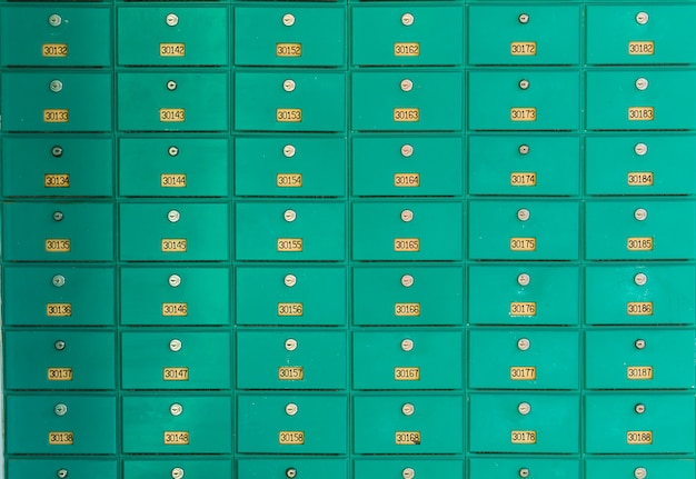 A row of green mailboxs. post office