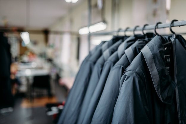 Row of jackets on hangers, clothing store, fabric