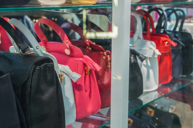 Row of ladies leather handbags .