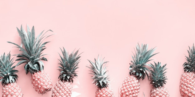 Row line pine apple whole tropical fruits pink