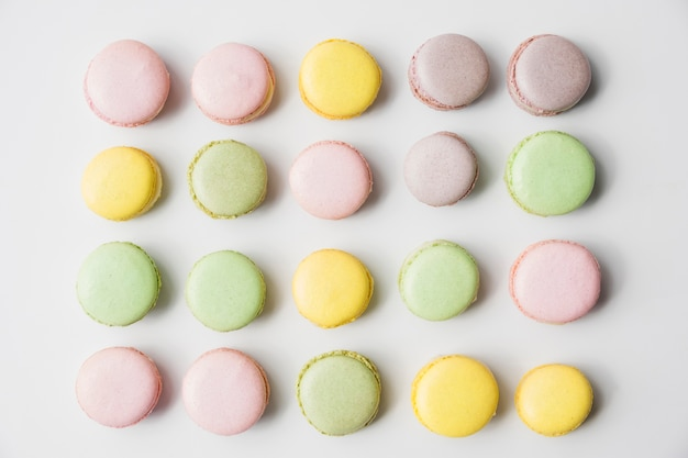 Row of macaroons on white backdrop