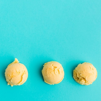 Row of mango ice cream scoops