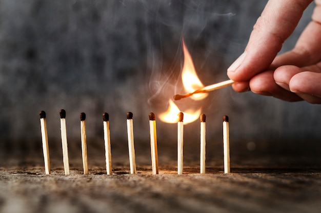 Row of matches on a wooden background