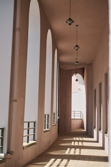 Row of modern columns with diminishing perspective corridor outside the building