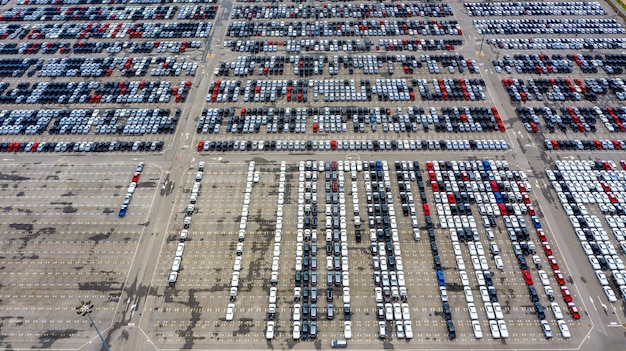 Row of new cars for sale in port at cars export terminal.