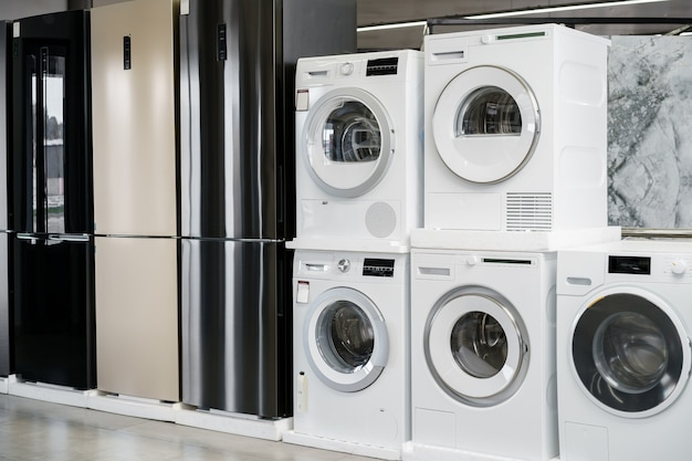 Row of new washing machines in a hypermarket