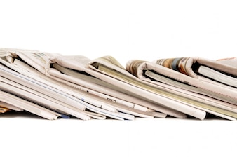 Row of folded newspapers