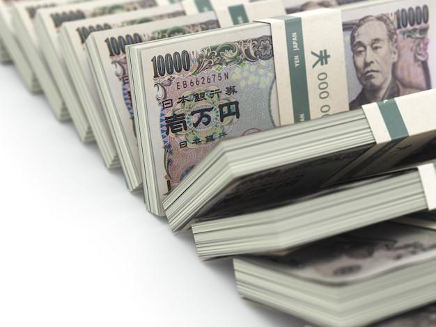 白い背景の上の日本円パックお金の行。 3d