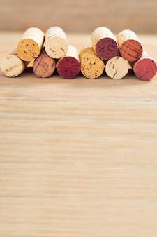 Row of old wine corks on wooden blurred background with copy space.