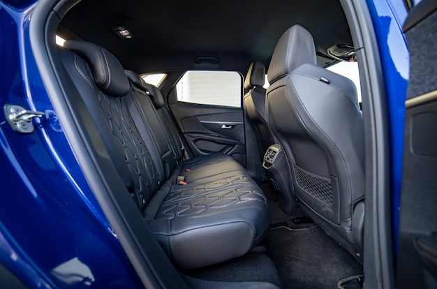 Row of passenger rear seats upholstered in drycleaned fabric presale preparation blue car