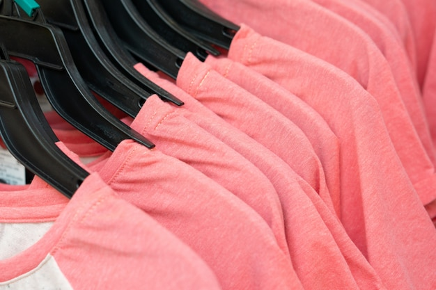 Row of pink t-shirts in a store