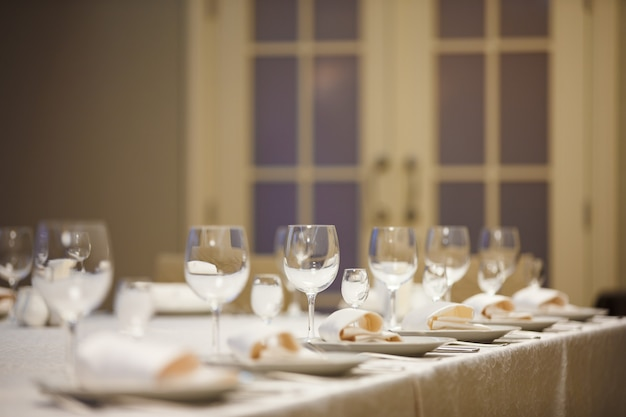 Row of place settings on table for a wedding reception.