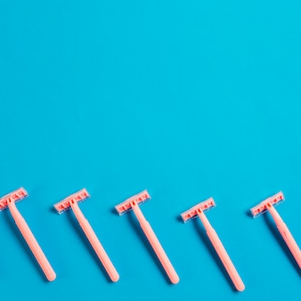 Row of razor on blue background