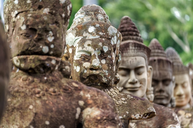 Row of sculptures in the south gate of angkor thom