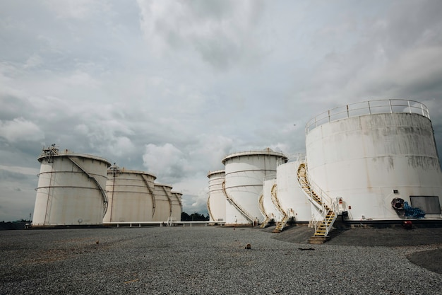 The row of small white tanks for petrol station and refinery spare part.