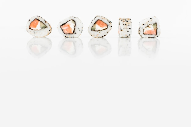 Row of sushi rolls japanese food on white background