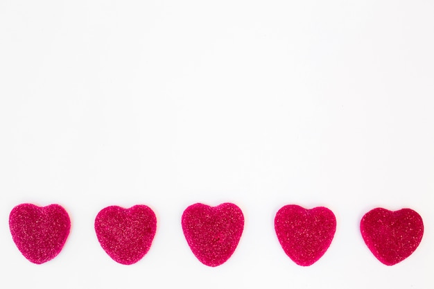 Row of sweet candies in form of hearts