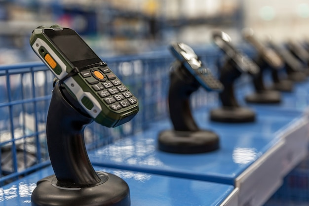 A row of terminals for cashless checkout at a supermarket. payment with bank card. foreground in focus.