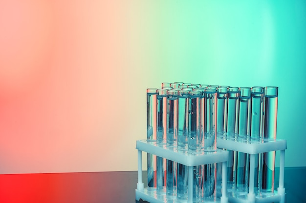 Row of test tubes with liquids on blue and green toned background