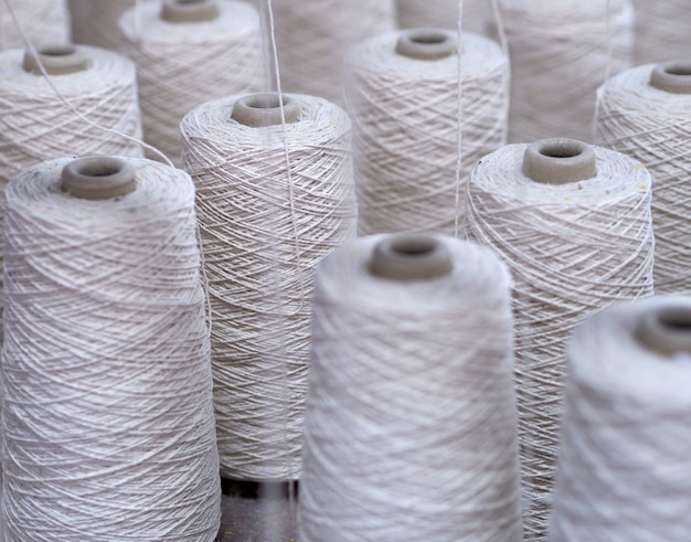 Row of textile threads industry