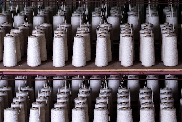 Row of textiles threads industry .
