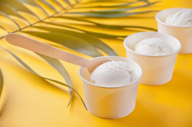 Row of vanilla ice cream and palm leaf