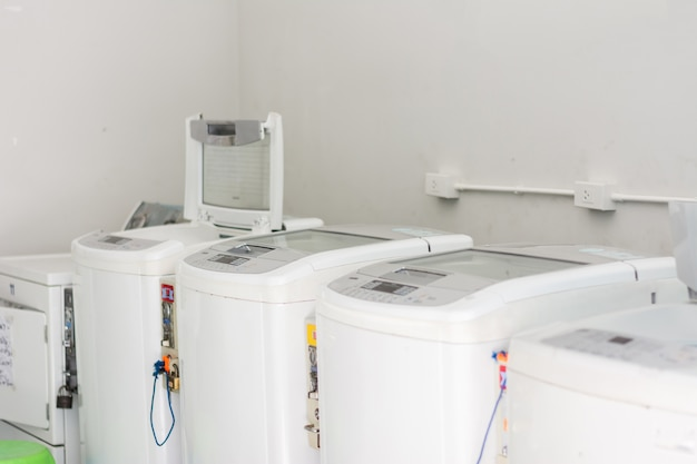 A row of washing machines in a public laundromat