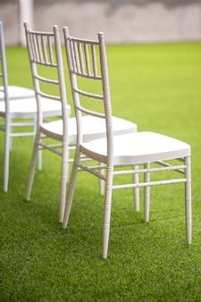 Row of white wedding chairs