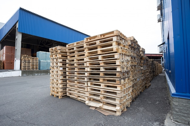 Row of wooden pallets in stock