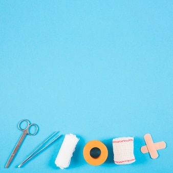 Row of wound dressing medical equipments on blue background