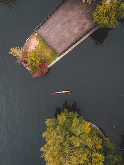 Rower training on the river in a kayak.