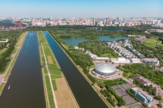 Rowing canal illuminated by bright sunshine. panoramic view. shooting from above, aerial filming. olympic rowing canal in moscow.