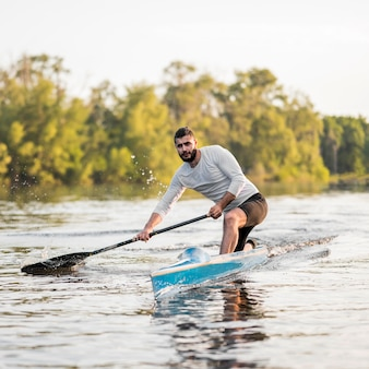 Rowing concept with man in canoe