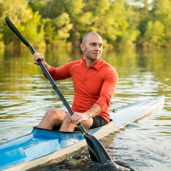 Rowing concept with man holding oar