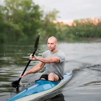 Rowing concept with man paddling