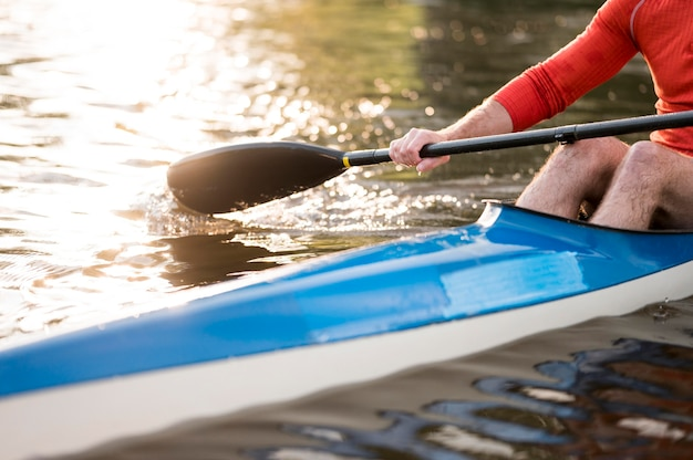 Rowing concept with oar and kayak