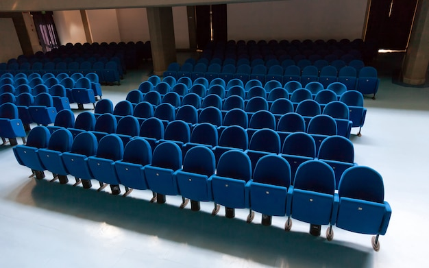 Rows of ble color theatre chairs