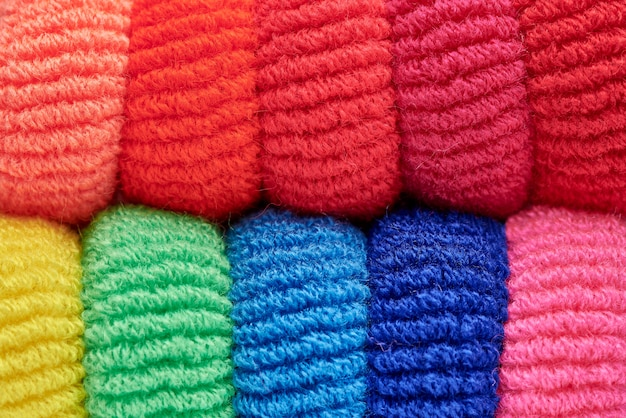 Rows of bright multi-colored soft scrunchy close-up.