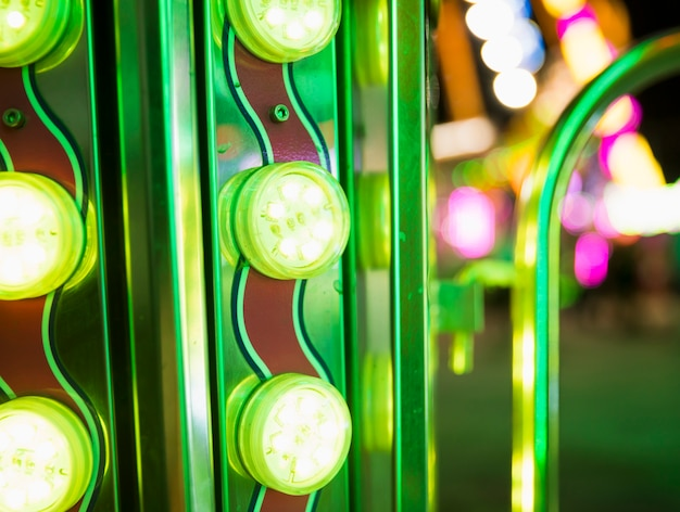 Rows of brightly colorful funfair lights