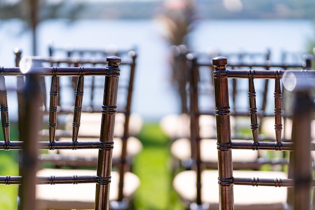 Rows of chairs for guests at an open-air wedding ceremony.