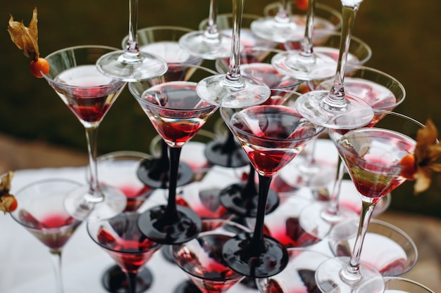 Rows of champagne glasses with color cocktails