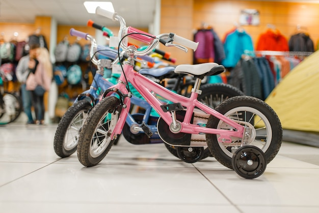 Rows of children's bicycles in sports shop