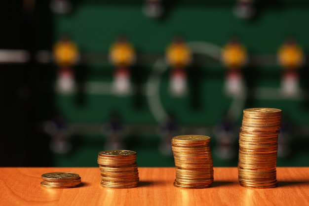 Rows of coins on display of stock market, grow money on board