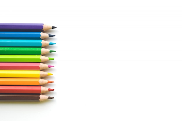 Rows of color pencils on white paper background, copy space. office supplies, back to school.